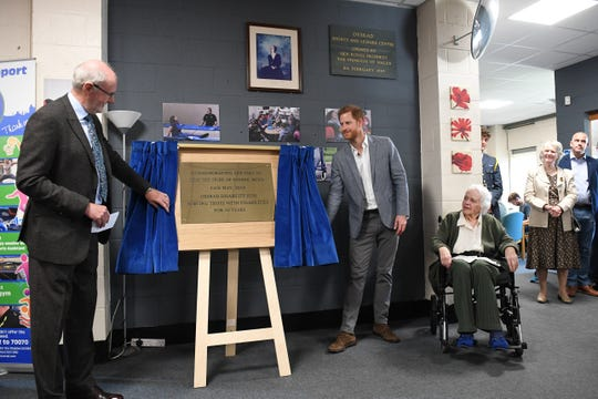 Prince Harry  unveils a plaque commemorating his visit to the OXSRAD Disability Sports and Leisure Center. It will be hung next to the one marking his mother's 1989 visit.