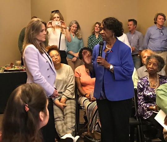 Anderson City Councilwoman Beatrice Thompson speaks Tuesday night to Democratic presidential candidate Marianne Thompson.