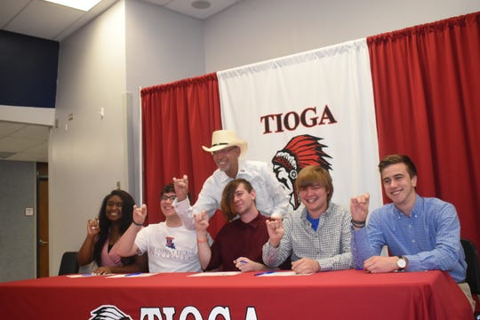 Tioga High School held their second annual Tioga High School Band Scholarship Signing Ceremony Tuesday for thirteen students who will be attending fiveÊarea schools.Ethan Byrd, Ah'Brittana Favor, Seth Lloyd and Avery Laffon and Zack Thornhill will attend Louisiana Tech University. On hand for the signing was Jim Robkin (back, center), director of bands, atÊLouisiana Tech University.