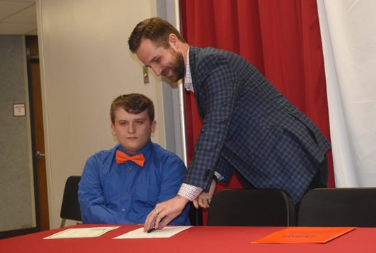 Tioga High School held their second annual Tioga High School Band Scholarship Signing Ceremony Tuesday for thirteen students who will be attending fivearea schools.Dustin Morace (pictured, left) and Christian Bowen will attend Louisiana College. Cameron Weatherford,chair of the division of fine arts and the director of chorale activities at Louisiana College, was on hand for the signing.