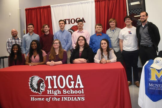 Tioga High School held their second annual Tioga High School Band Scholarship Signing Ceremony Tuesday for thirteen students who will be attending fiveÊarea schools.Christian Bowen and Dustin Morace will attend Louisiana College; Ethan Byrd, Ah'Brittana Favor, Seth Lloyd and Avery Laffon and Zack Thornhill will attend Louisiana Tech University; Kloei Hodges, Leah Morace and Taylor Tyson will attend Northwestern State University; Kade Smith will attend the University of Louisiana at Monroe and Katelyn Boyer and JaLissa Chew will attend McNeese State University. Ty Lee (back, far left) is the Tioga High School band director and Aaron Martin, (back, far right) is the assistant band director.