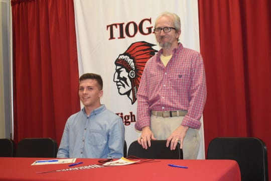 """Tioga High School held their second annual Tioga High School Band Scholarship Signing Ceremony Tuesday for thirteen students who will be attending fiveÊarea schools.Kade Smith will attend the University of Louisiana at Monroe. On hand for the signing was Steve Pederson, director of the """"Sound of Today"""" Marching Band at the University of Louisiana at Monroe."""