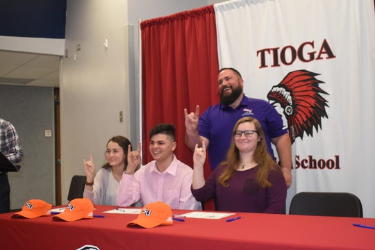 Tioga High School held their second annual Tioga High School Band Scholarship Signing Ceremony Tuesday for thirteen students who will be attending fiveÊarea schools.Kloei Hodges, Leah Morace and Taylor Tyson will attend Northwestern State University. On hand for the signing was Dan McDonald, acting director of bands at Northwestern State University.