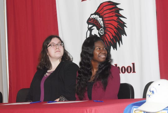 Tioga High School held their second annual Tioga High School Band Scholarship Signing Ceremony Tuesday for thirteen students who will be attending fiveÊarea schools.Katelyn Boyer and JaLissa Chew will attend McNeese State University. Jay Sconyers, assistant director of bands at McNeese State University, sent them a welcome video.