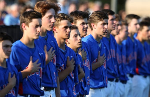 West Henderson players line up for the national anthem before their 9-5 loss at North Gaston Tuesday evening.  [JOHN CLARK/THE GASTON GAZETTE]