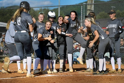 North Buncombe's Karlyn Pickens is cheered home by her teams after hitting a home run in the third round playoff game against Jesse Carson May 14, 2019 in Weaverville. North Buncombe won, 4-0.