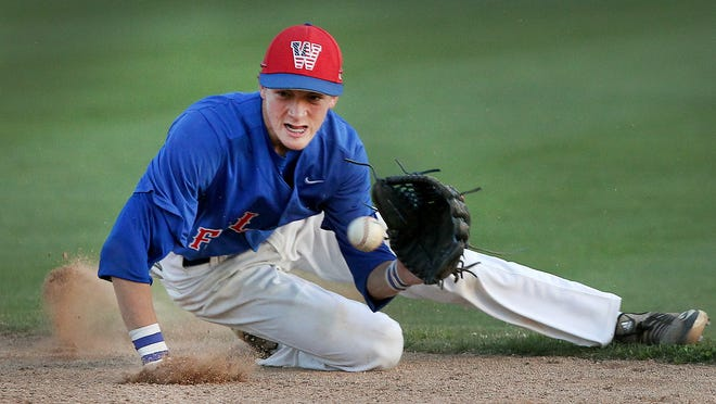 West Henderson second baseman Mykah Johnson makes a diving stop on a ground ball during their 9-5 loss at North Gaston Tuesday evening.  [JOHN CLARK/THE GASTON GAZETTE]
