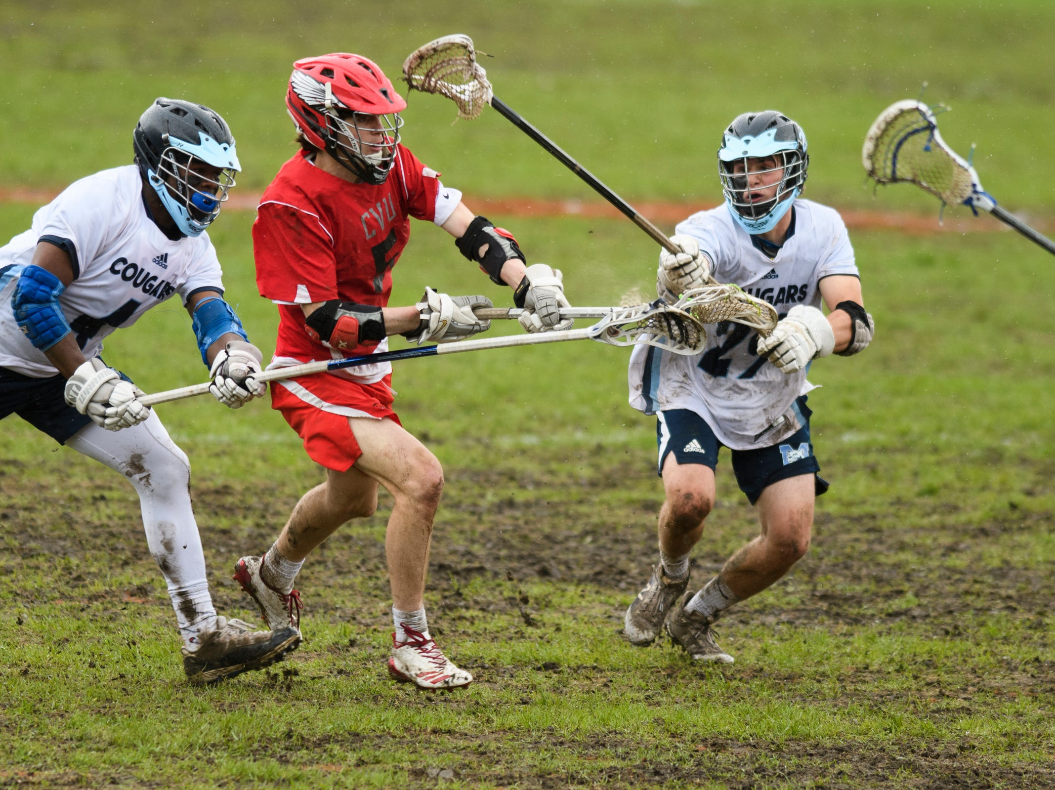 CVU's Jake Schaefer (5) shoots the ball during the boys lacrosse game between the Champlain Valley Union Redhawks and the Mount Mansfield Cougars at MMU High School on Tuesday afternoon May 14, 2019 in Jericho, Vermont.