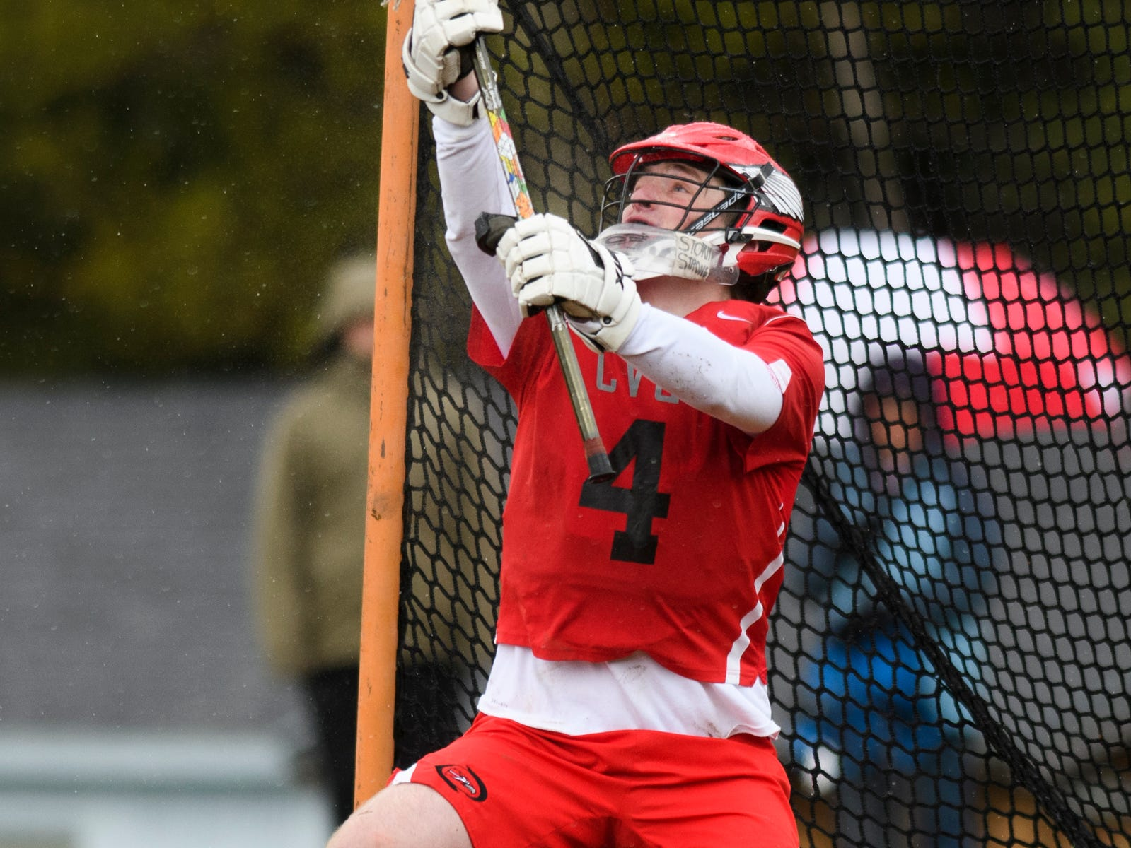 CVU goalie Bobby Spencer (4) makes a save during the boys lacrosse game between the Champlain Valley Union Redhawks and the Mount Mansfield Cougars at MMU High School on Tuesday afternoon May 14, 2019 in Jericho, Vermont.