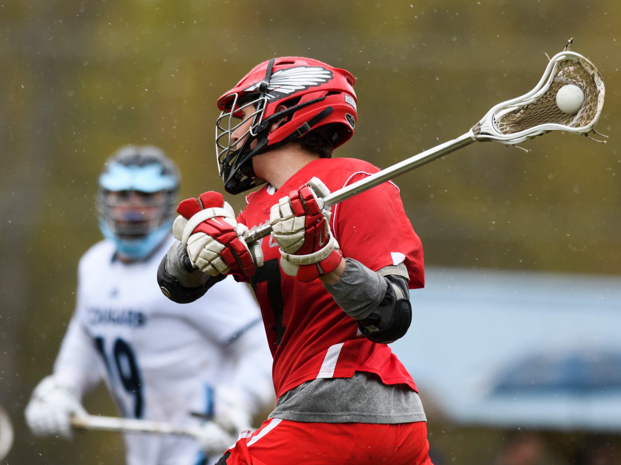 CVU's Charlie Averill (7) shoots the ball during the boys lacrosse game between the Champlain Valley Union Redhawks and the Mount Mansfield Cougars at MMU High School on Tuesday afternoon May 14, 2019 in Jericho, Vermont.