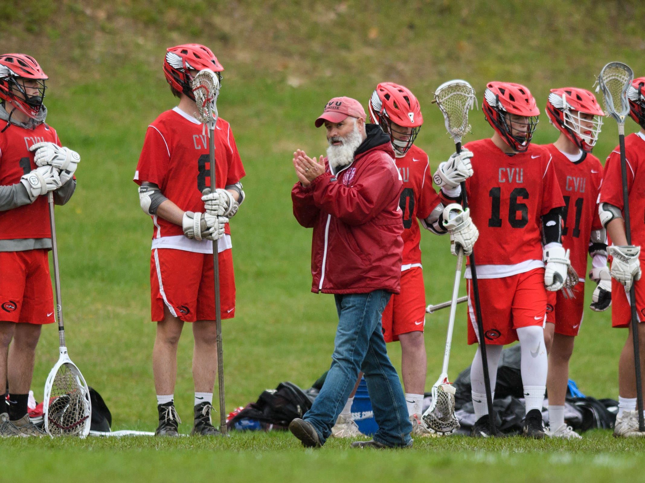 CVU head coach Dave Trevithick cheers for the team during the boys lacrosse game between the Champlain Valley Union Redhawks and the Mount Mansfield Cougars at MMU High School on Tuesday afternoon May 14, 2019 in Jericho, Vermont.