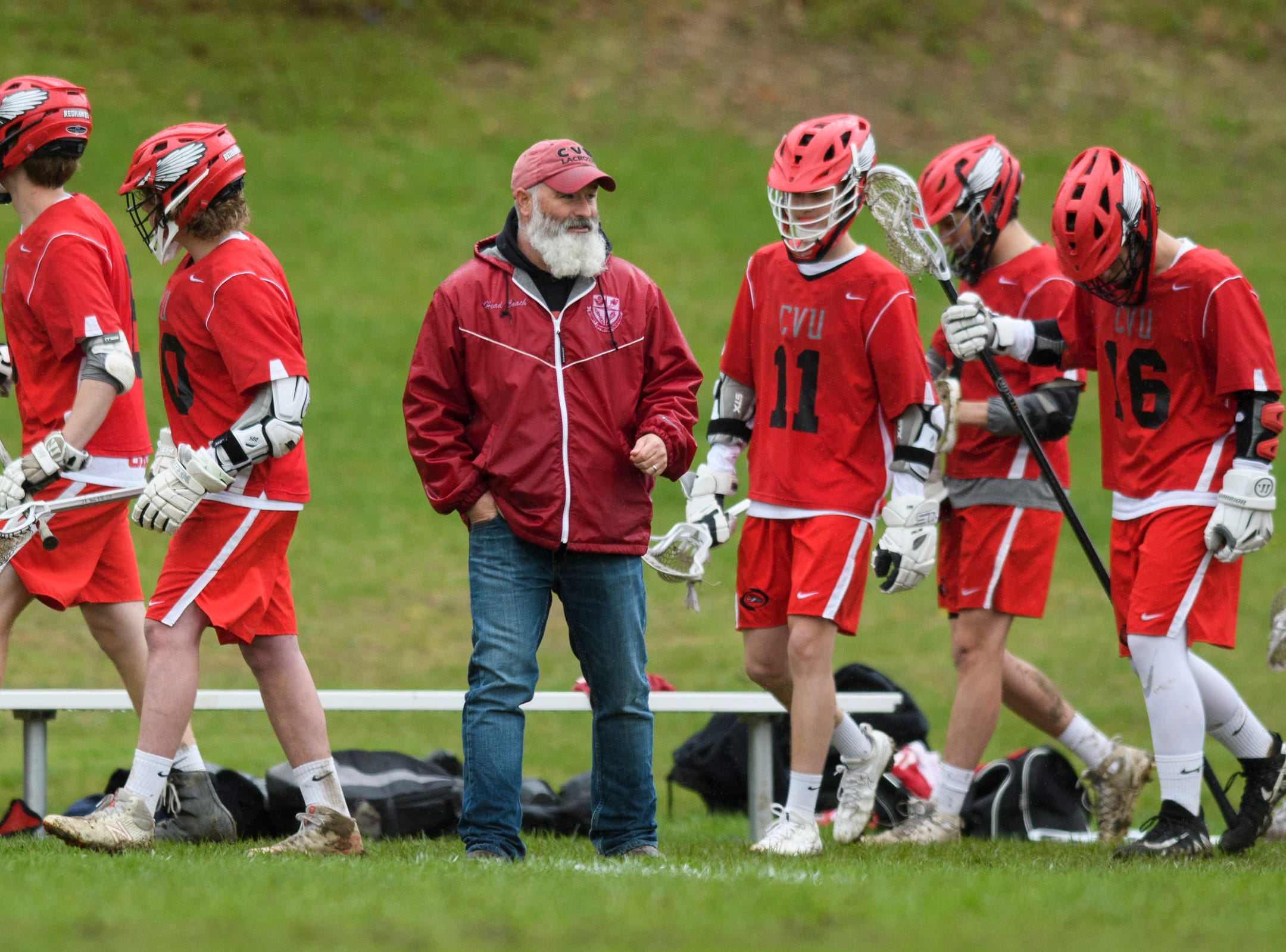 CVU head coach Dave Trevithick watches the action on the field during the boys lacrosse game between the Champlain Valley Union Redhawks and the Mount Mansfield Cougars at MMU High School on Tuesday afternoon May 14, 2019 in Jericho, Vermont.