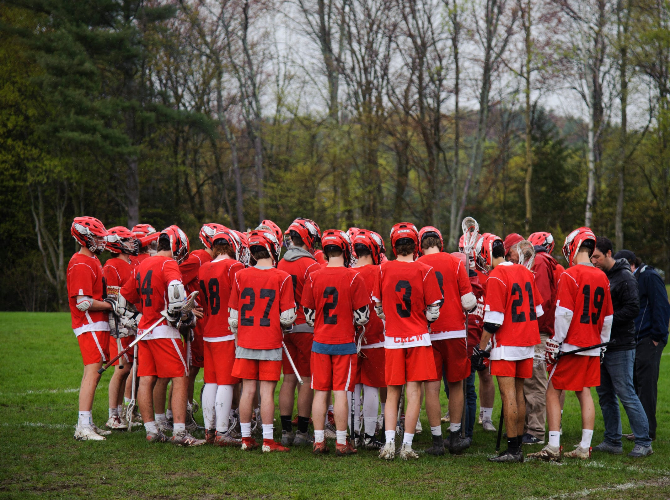 CVU huddles together during the boys lacrosse game between the Champlain Valley Union Redhawks and the Mount Mansfield Cougars at MMU High School on Tuesday afternoon May 14, 2019 in Jericho, Vermont.