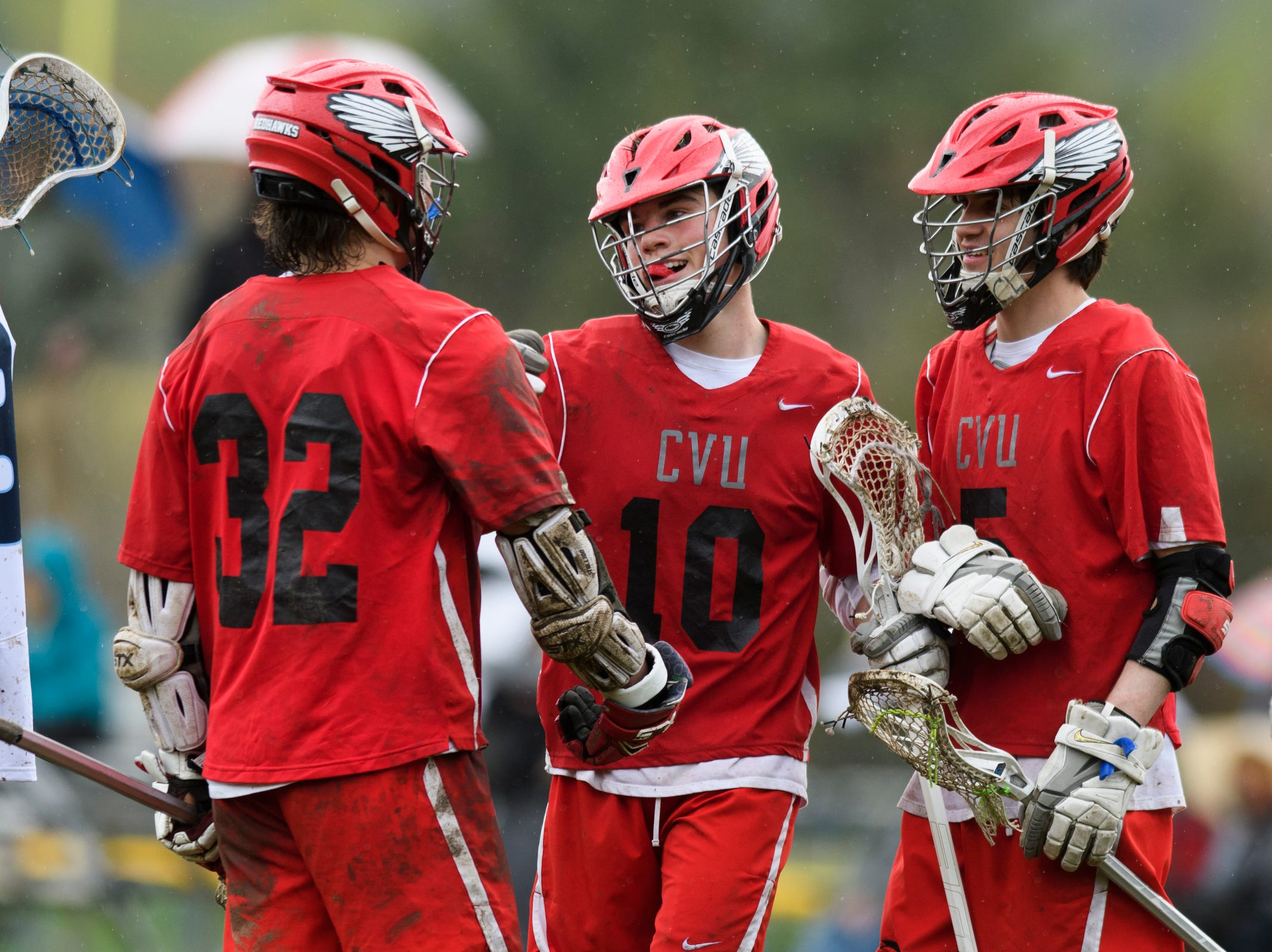 CVU's Max Gorman (10) celebrates a goal with Jake Schaefer (5) and James Bernicke (32) during the boys lacrosse game between the Champlain Valley Union Redhawks and the Mount Mansfield Cougars at MMU High School on Tuesday afternoon May 14, 2019 in Jericho, Vermont.