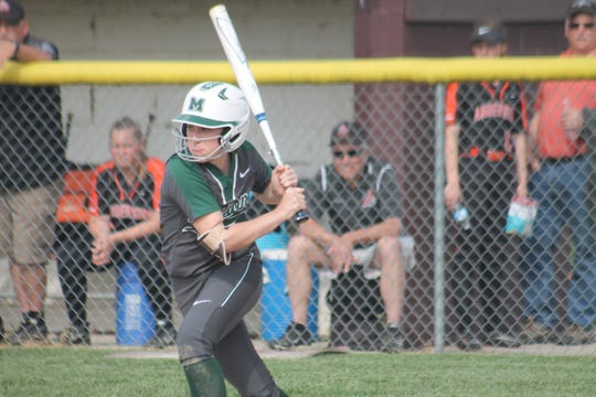Sophomore Sydney Carter takes the running slap at the ball for Mason. Carter has been a top hitter in the GMC.