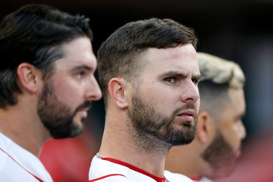 Cincinnati Reds left fielder Jesse Winker (33) looks to the video board in the fifth inning of the MLB National League game between the Cincinnati Reds and the Chicago Cubs at Great American Ball Park in downtown Cincinnati on Tuesday, May 14, 2019. The Cubs took the first game of the series, 3-1.