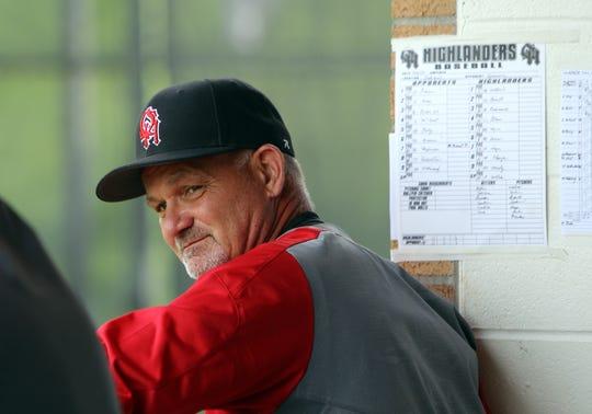 Oak Hills head coach Chuck Laumann looks on from the Highlanders' dugout. Oak Hills defeated Sycamore 5-0.