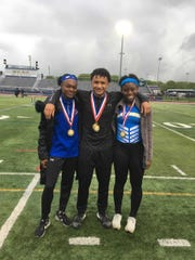 North Brunswick runners Adelaide Asante, Ramy Berberena and Nakaja Weaver after winning gold medals at the 2019 GMC Championships.