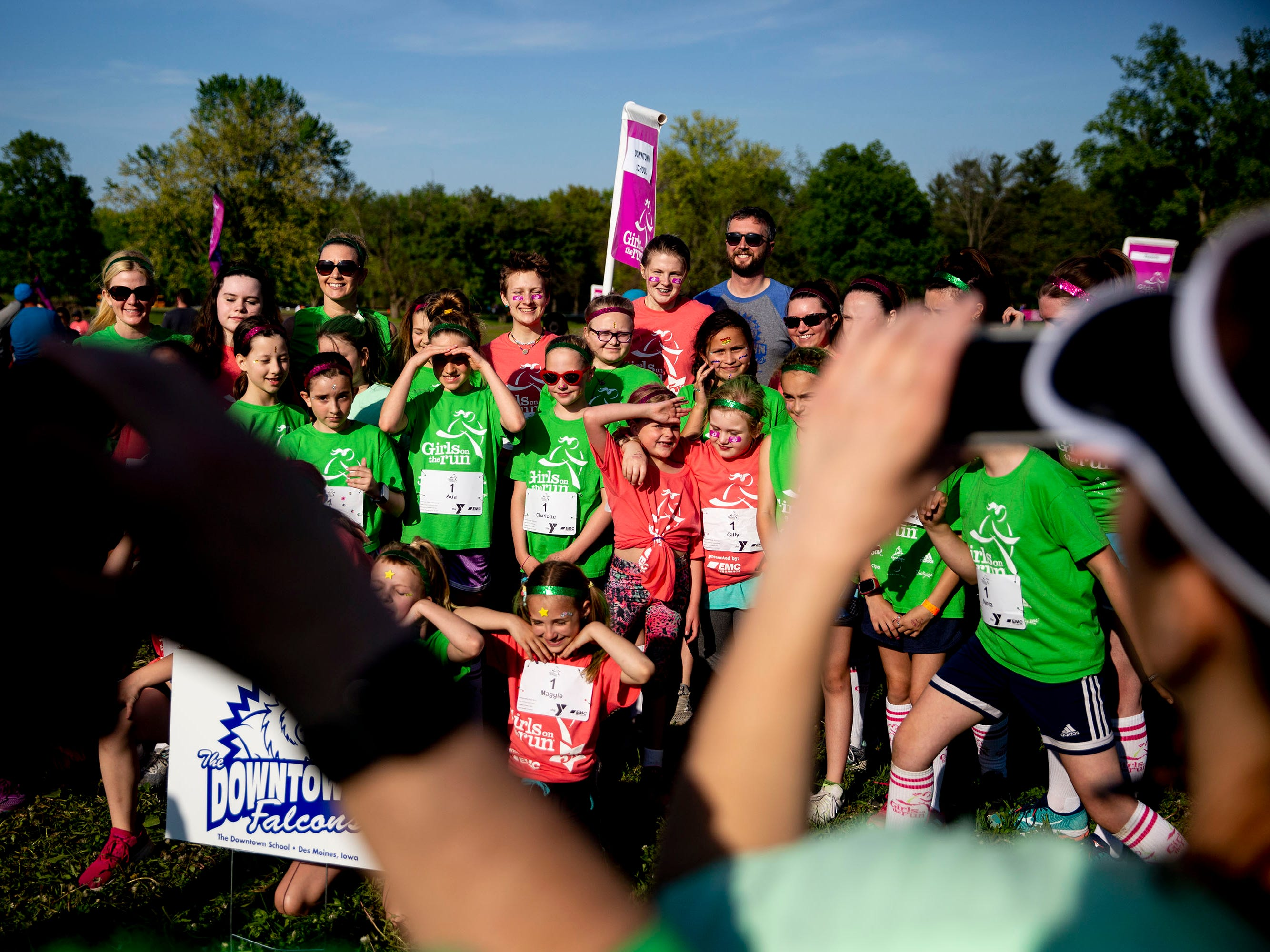 A group of runners poses for a photo before the Girls on the Run celebration 5K on Tuesday, May 14, 2019, in Water Works Park in Des Moines.