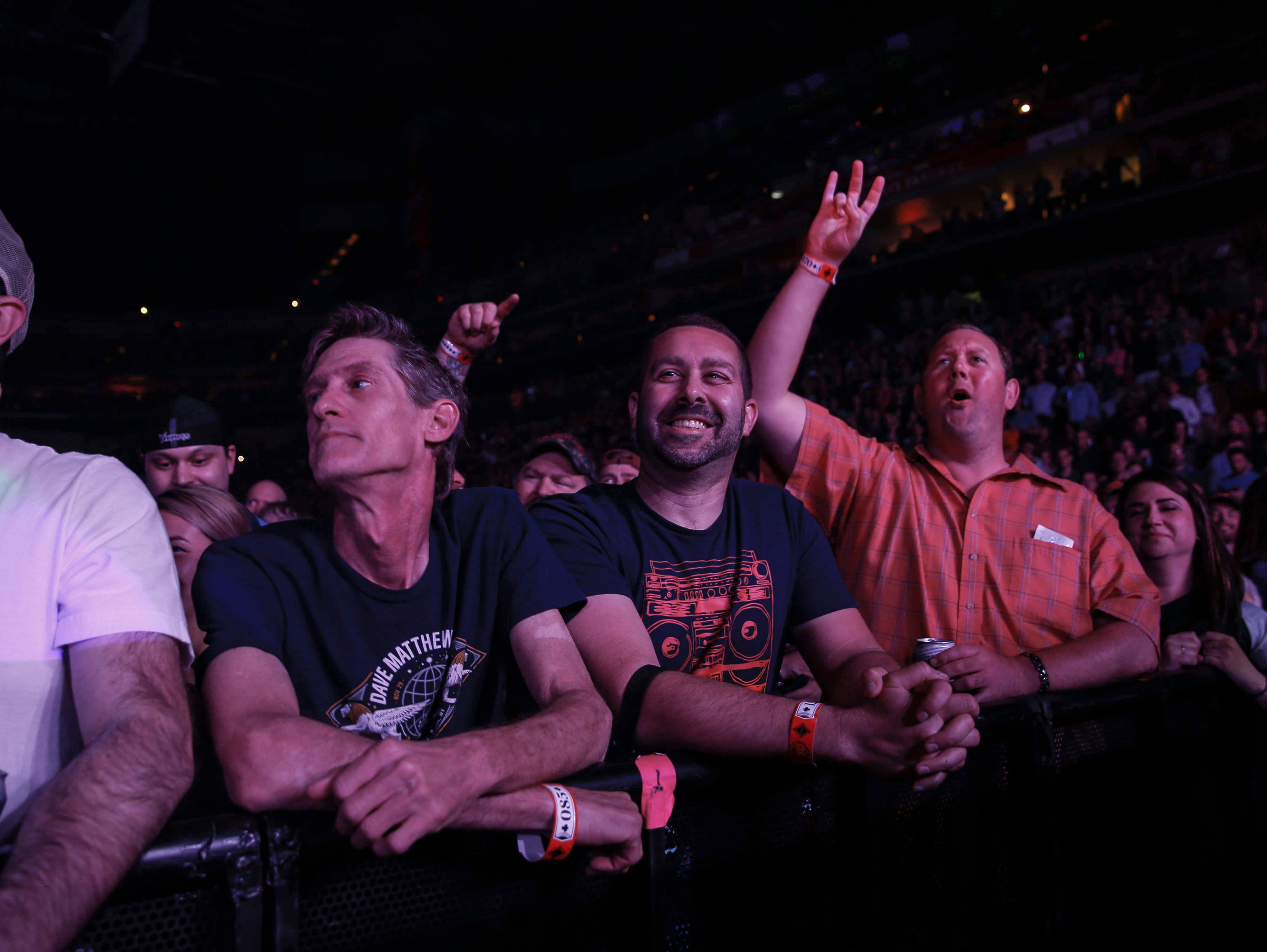 Fans of the Dave Matthews Band cheer during Tuesday's performance in front of a packed Wells Fargo Arena in Des Moines.