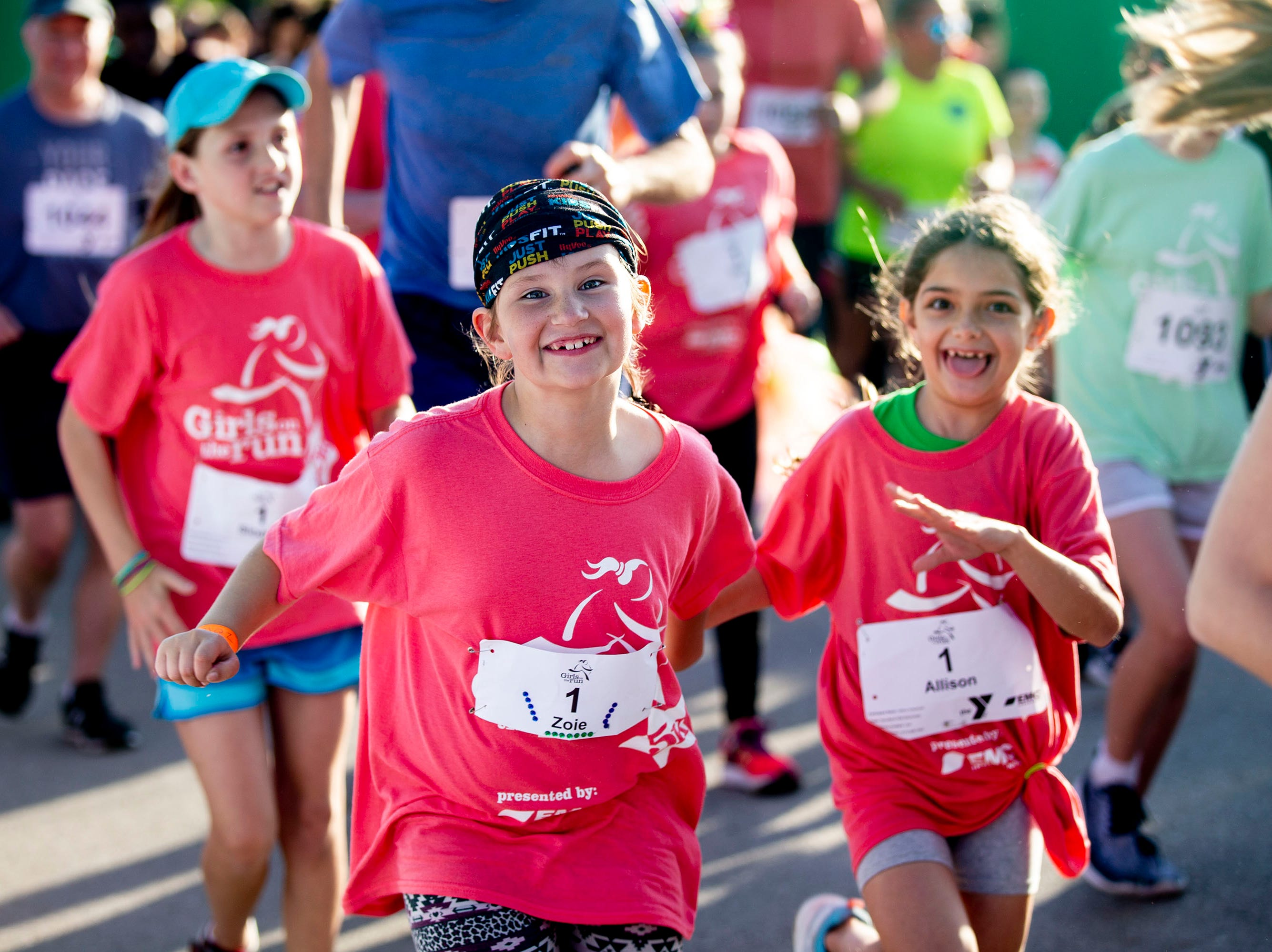 Runners take off from the start of the Girls on the Run 5K on Tuesday, May 14, 2019, in Water Works Park in Des Moines. The 5K is a celebration for the 800 girls in Central Iowa, marking the end of the spring season of Girls on the Run.