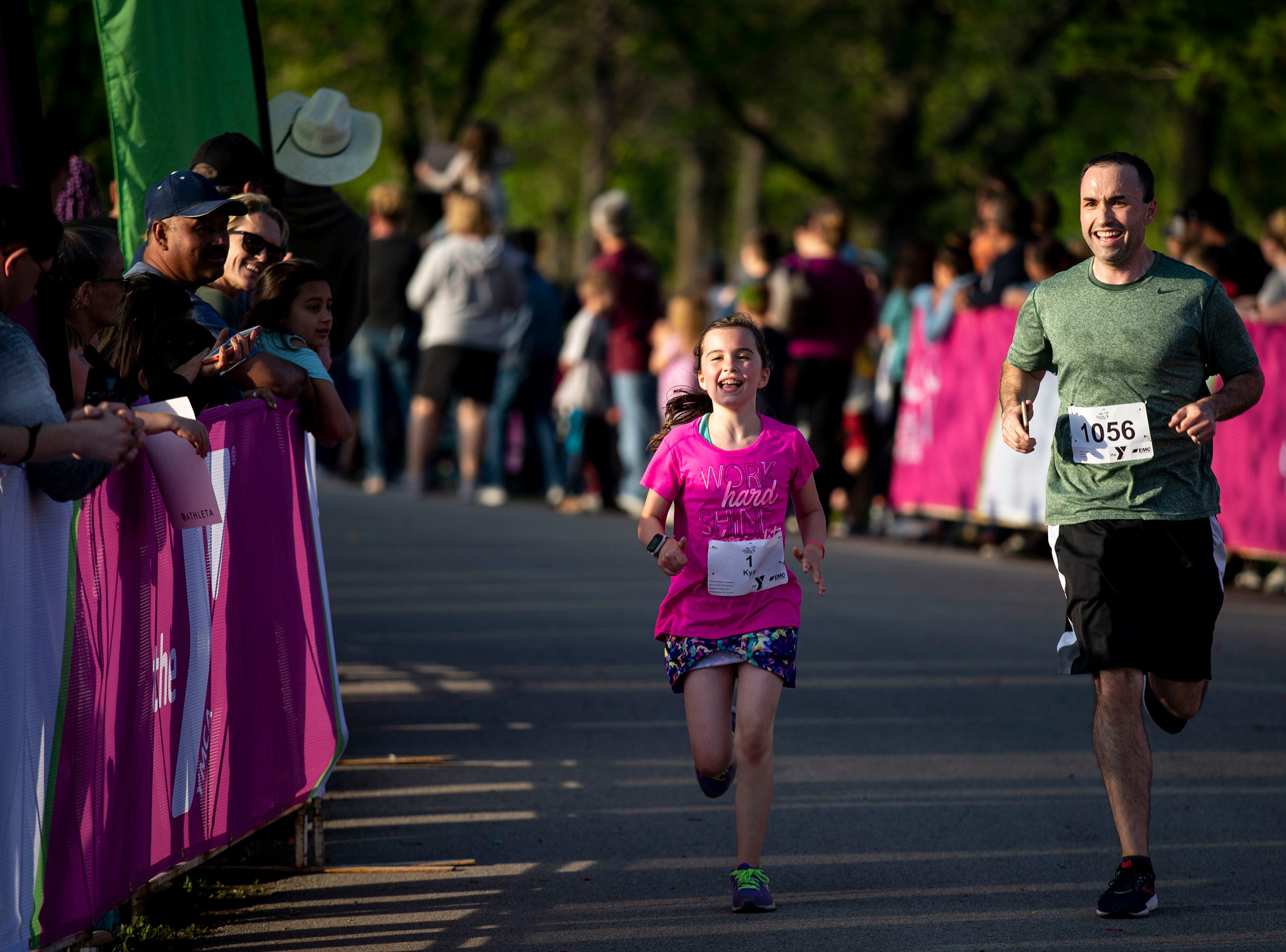 Runners make their way to the finish of the Girls on the Run 5K on Tuesday, May 14, 2019, in Water Works Park in Des Moines. The 5K is a celebration for the 800 girls in Central Iowa, marking the end of the spring season of Girls on the Run.