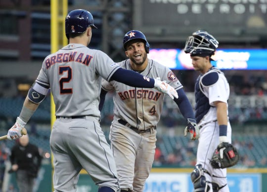Houston Astros right fielder George Springer celebrates with Alex Bergman after his inside-the-park homer against Detroit Tigers pitcher Buck Farmer during fifth inning action Tuesday, May 14, 2019 at Comerica Park in Detroit, Mich.