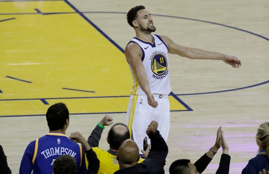 Golden State Warriors guard Klay Thompson (11) celebrates with fans after scoring against the Portland Trail Blazers during the second half of Game 1 Tuesday. The Warriors won 116-94 to take a 1-0 lead in the Western Conference finals best-of-seven series.
