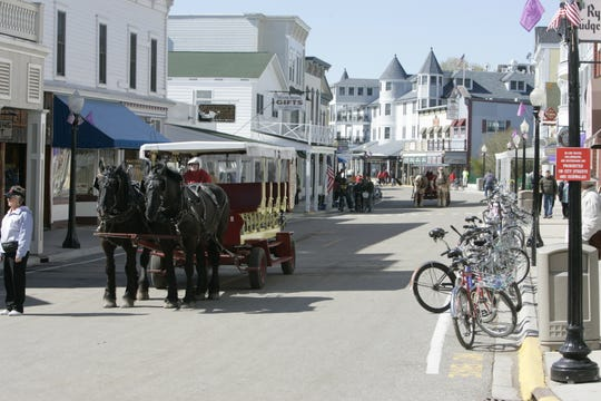 May 27th,2008   Mackinac Island Mi.     The Detroit Regional Chamber begins to arrive on Mackinac Island. The main street of Mackinac Island is filled with vistors again as the Michigan Chamber Conference opens for the kick off of tourist season in Michigan.  Horse and Buggys and Fudge seem to be the first smells of the year. _ Photos by Charles V. Tines, The Detroit News.