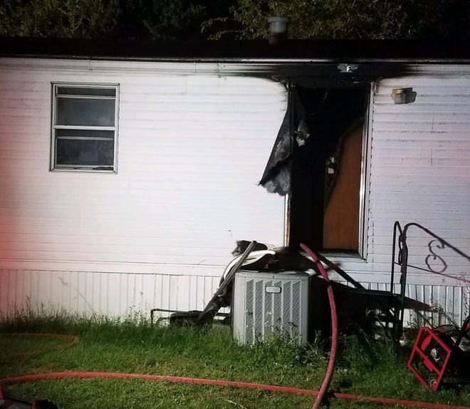 The scene of a mobile home fire in the 6100 block of Rockford Drive in Evansville Tuesday. A man was arrested after assaulting his wife and setting fire to the home when police officers arrived.