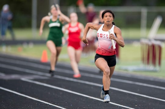 Bosse's Tionne Brighan runs the last leg of the 4x100 meter relay during the 2019 IHSAA Girls Track and Field Sectionals at Memorial Field in Mt. Vernon, Ind. Tuesday, May 14, 2019.