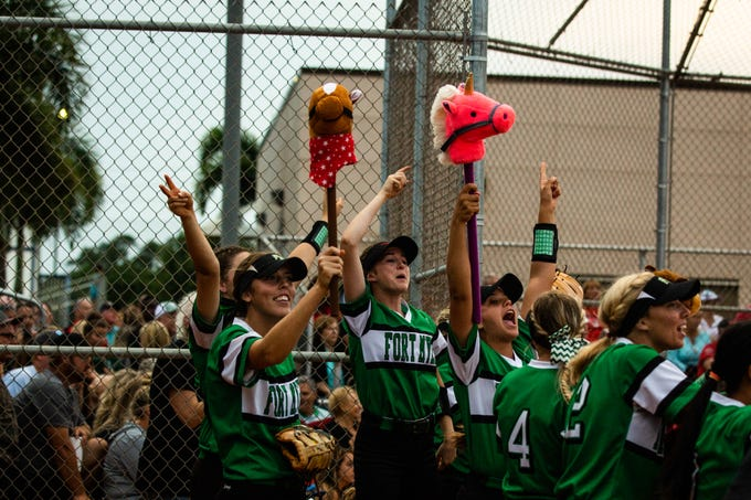 Members of the Fort Myers High School softball team cheer from the dugout during the Class 7A regional semifinal on Tuesday, May 14, 2019 at Estero High School in Estero.