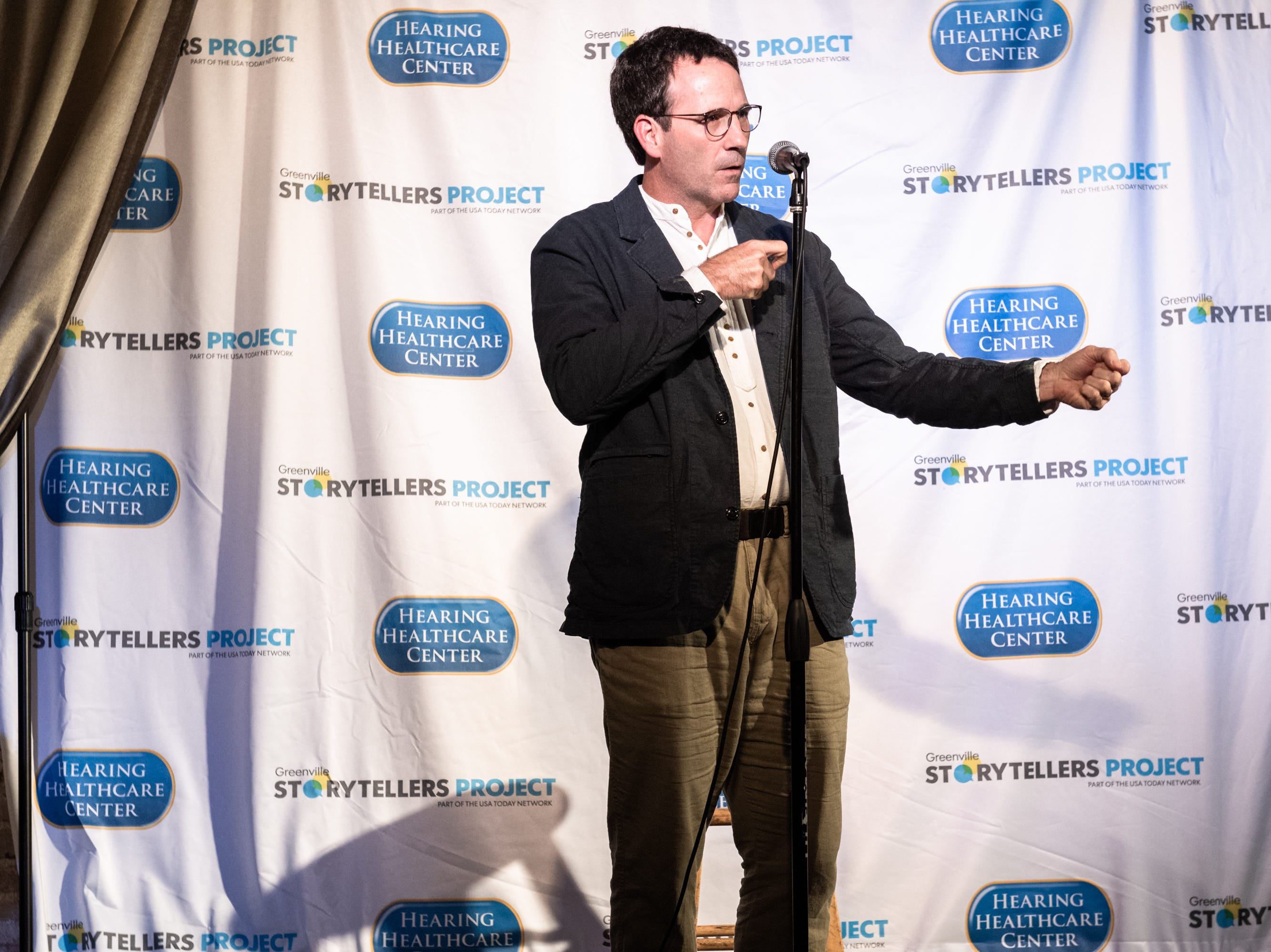 Adam Tyson, an obsetetrician, at the Greenville Storytellers Project event at the Comedy Zone Tuesday, May 14, 2019.