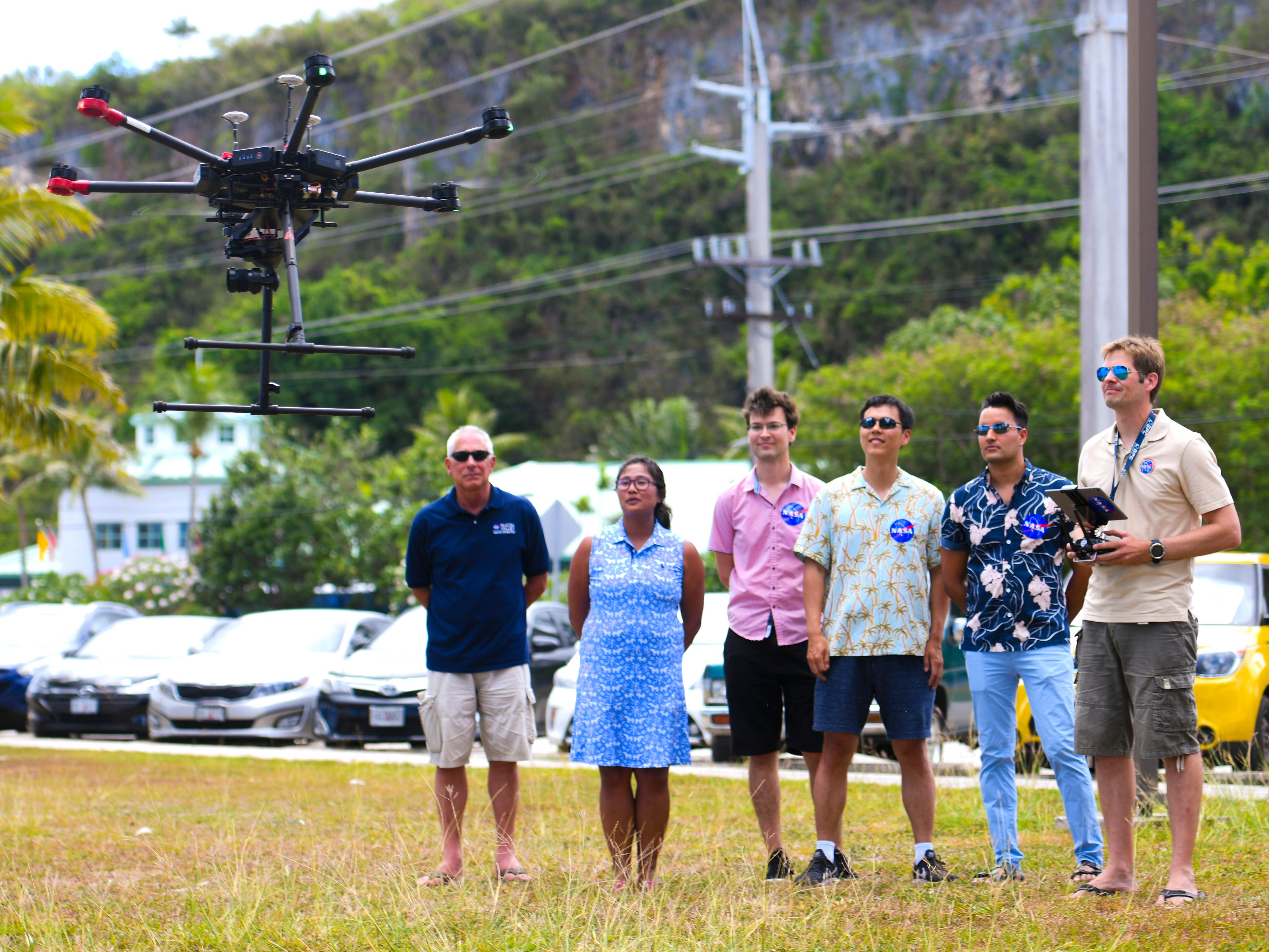 Romina King, second from left, University of Guam's Pacific Islands Climate Adaptation Science Center program director, stands with a research team from NASA, including Ved Chirayath, second from right, as NASA research engineer Jonas Jonsson launches an unmanned aerial vehicle in to the air at Tepungan Beach Park, near Fisheye Marine Park in Piti, on Wednesday, May 15, 2019. The drone, using Fluid Lensing technology developed by Chirayath, has been able to map the underwater coral reef in the waters of Piti and Tumon from the air.
