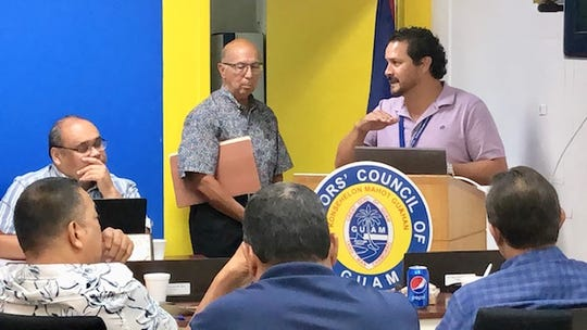 Guam Waterworks Authority General Manager Miguel Bordallo, left, gestures as he addresses village mayors on Wednesday about GWA's five-year capital improvement and financial plan that would result in an increase in customers' monthly water bills.