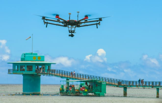 A NASA unmanned aerial vehicle hovers above the waters off Tepungan Beach Park, near Fisheye Marine Park in Piti, on Wednesday, May 15, 2019. The University of Guam's Pacific Islands Climate Adaptation Science Center has been working in tandem with a scientific research team from NASA to use the drone, and Fluid Lensing technology, to map the underwater coral reef of Piti and Tumon, from the air.