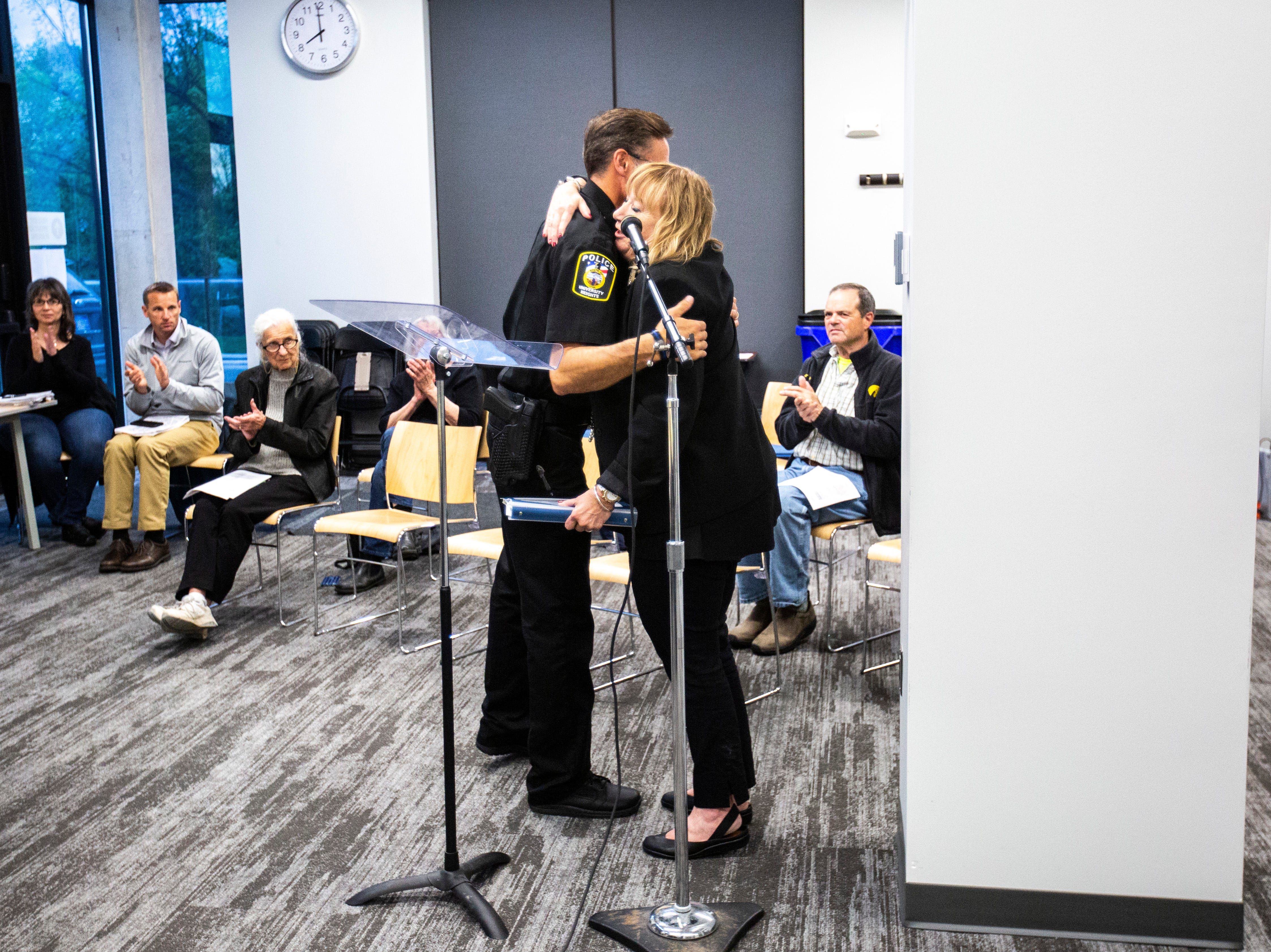 University Heights Police Chief Troy Kelsay, left, hugs Mayor Louise From, Tuesday, May 14, 2019, at City Hall in University Heights, Iowa.