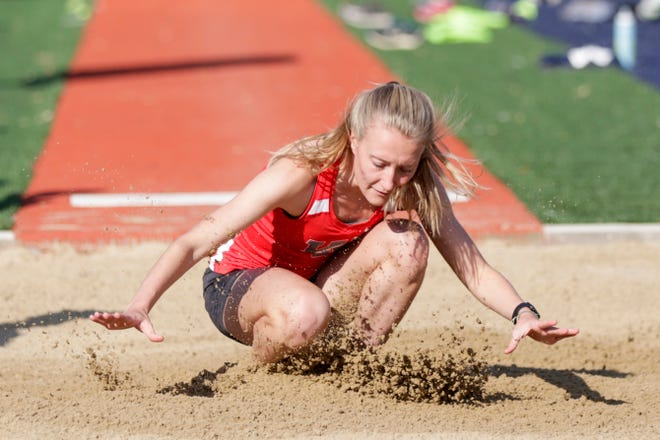 West Lafayette's Katy Penquite competes in the girls long jump during the Harrison Girls Track Sectional, Tuesday, May 14, 2019, in West Lafayette.