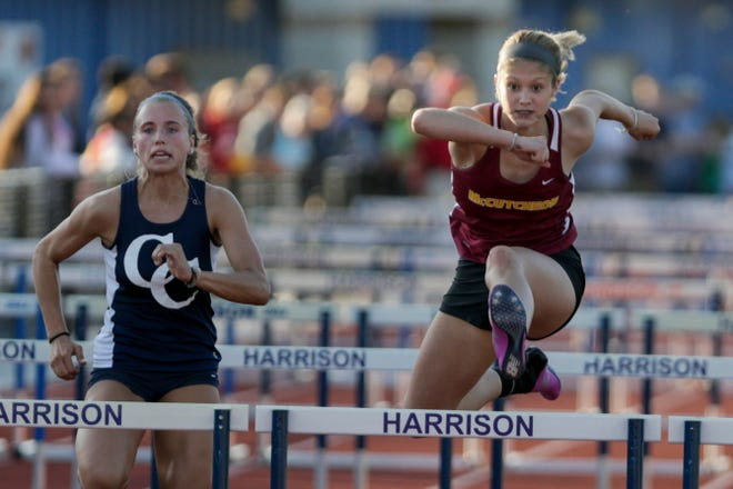 McCutcheon's Shianne Switzer, right, and Central Catholic's Kayla Brady compete in the girls 100 meter hurdles during the Harrison Girls Track Sectional, Tuesday, May 14, 2019, in West Lafayette.