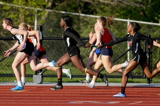 Lafayette Jeff's Nykela Haskins hands off the baton to Courtney Beckford as they compete in the girls 4x100 meter relay during the Harrison Girls Track Sectional, Tuesday, May 14, 2019, in West Lafayette.