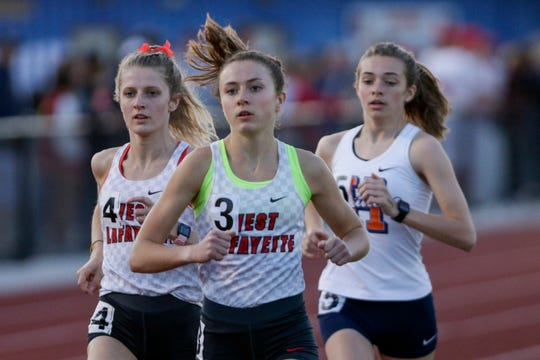 West Lafayette's Mary Schultz and Emma Tate compete in the girls 3200 meter run during the Harrison Girls Track Sectional, Tuesday, May 14, 2019, in West Lafayette.