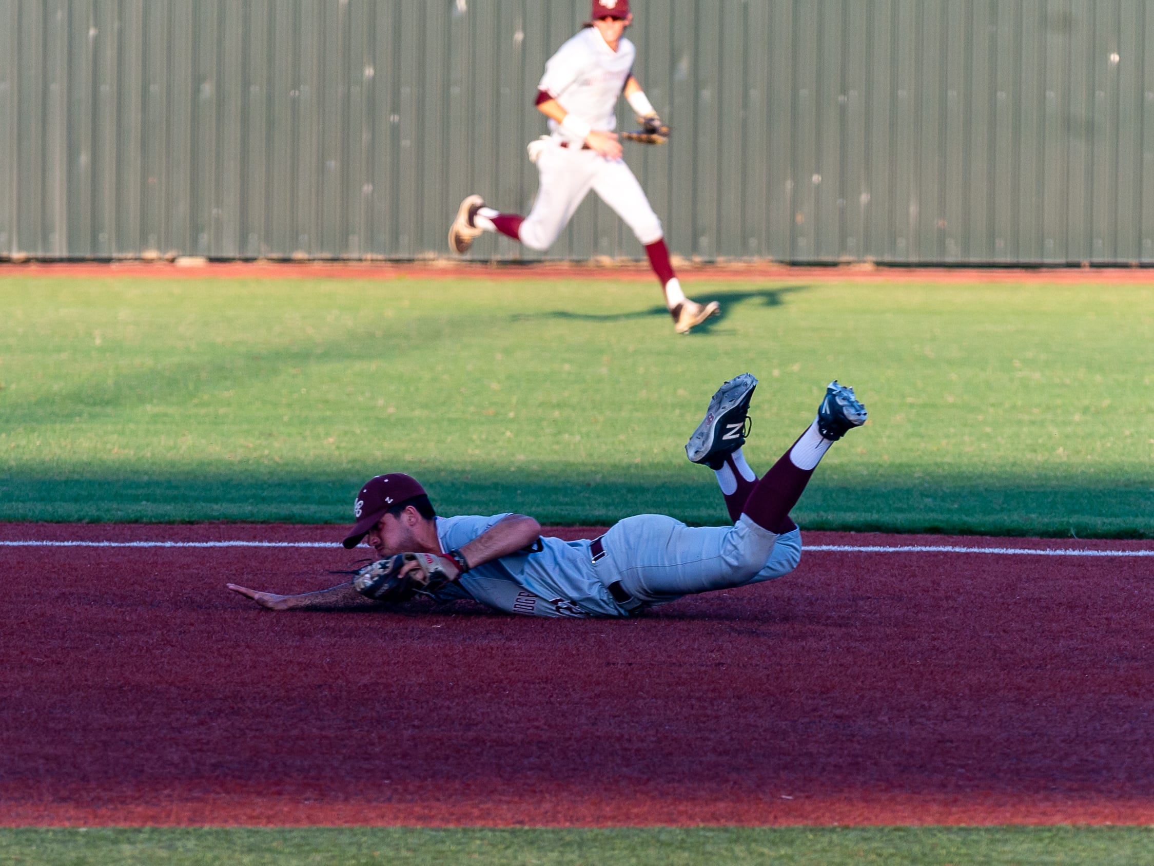 Cole Mouton makes a diving catch and throws the runner out as Breaux Bridge falls to Tioga High School in the LHSAA Class 4A Championship Game. Tuesday, May 14, 2019.