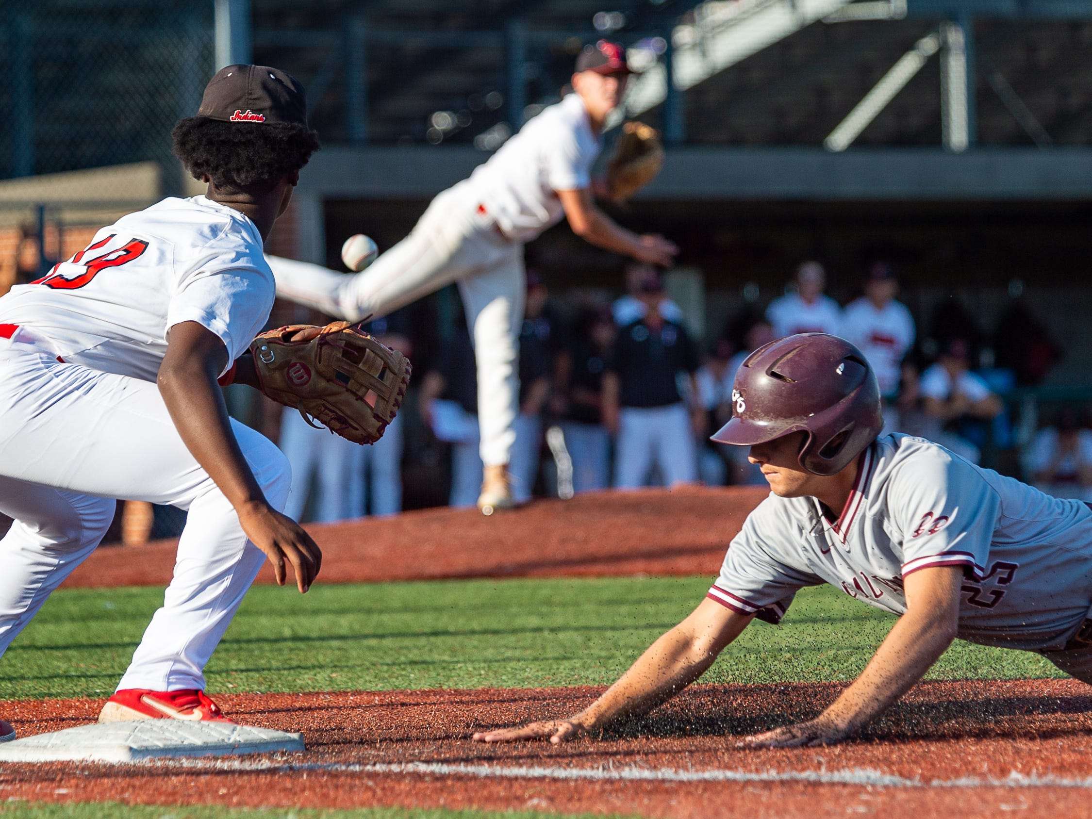 Christian Gonzalez is safe at first as Breaux Bridge falls to Tioga High School in the LHSAA Class 4A Championship Game. Tuesday, May 14, 2019.