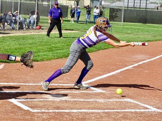 Bloom-Carroll senior Madison Smith lays down a bunt during the Bulldogs 10-3 win over Licking Valley on Tuesday.