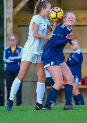 Novi's Eva Burns (left) and Hartland's Julia Pietila battle for the soccer ball on Tuesday, May 14, 2019.
