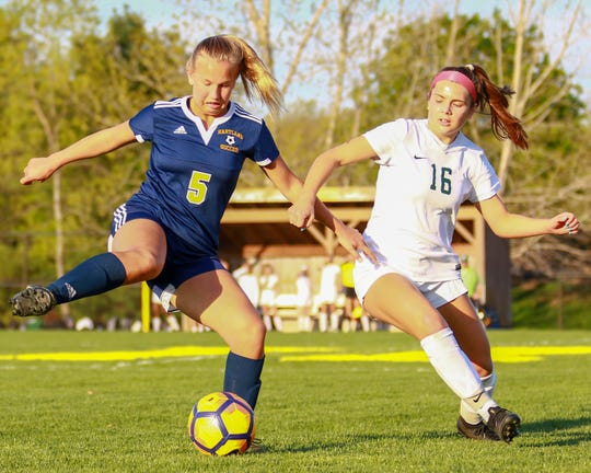 Maria Storm, who scored Hartland's first goal in a 3-2 loss, keeps the ball away from Novi's Jessica Bandyk on Tuesday, May 14, 2019.