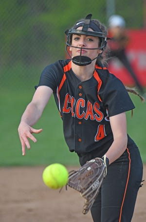 Lucas pitcher Erica Westfield hurls the ball towards home plate Tuesday night during a game with Plymouth.