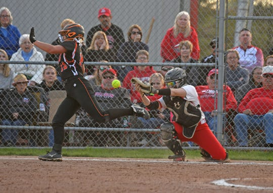 Plymouth catcher Shilo Plank can't hold on to the ball as she tries to tag out Morgan Spitler of Lucas on Tuesday night at Shelby High School.