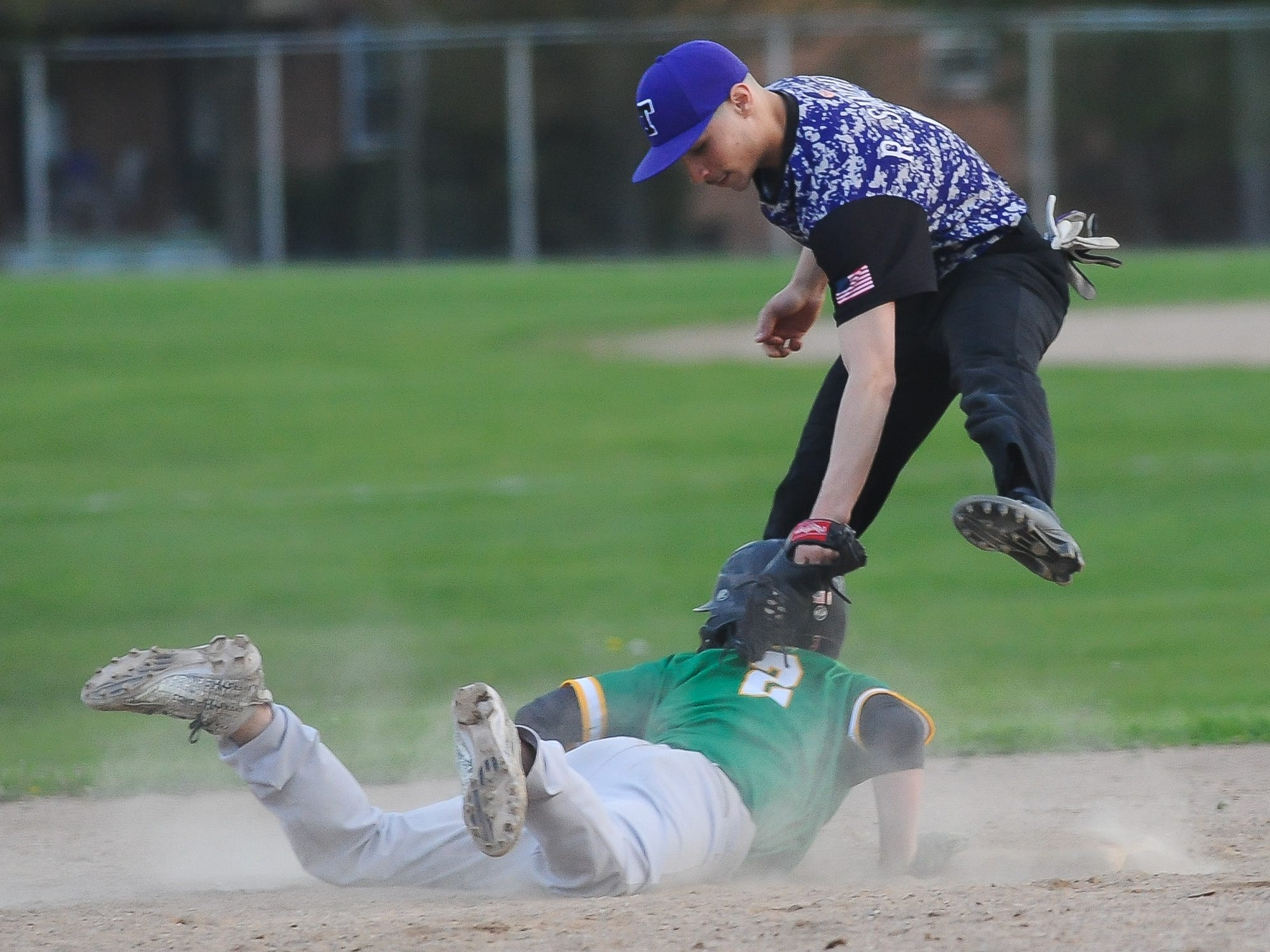 Milwaukee Hamilton's Antonio Barachy beats the tag by Milwaukee Bradley Tech second baseman Raudie Sanchez on a pickoff attempt in a City Conference baseball game Tuesday, May 14, 2019, at Hogan Field at Hamilton High School.
