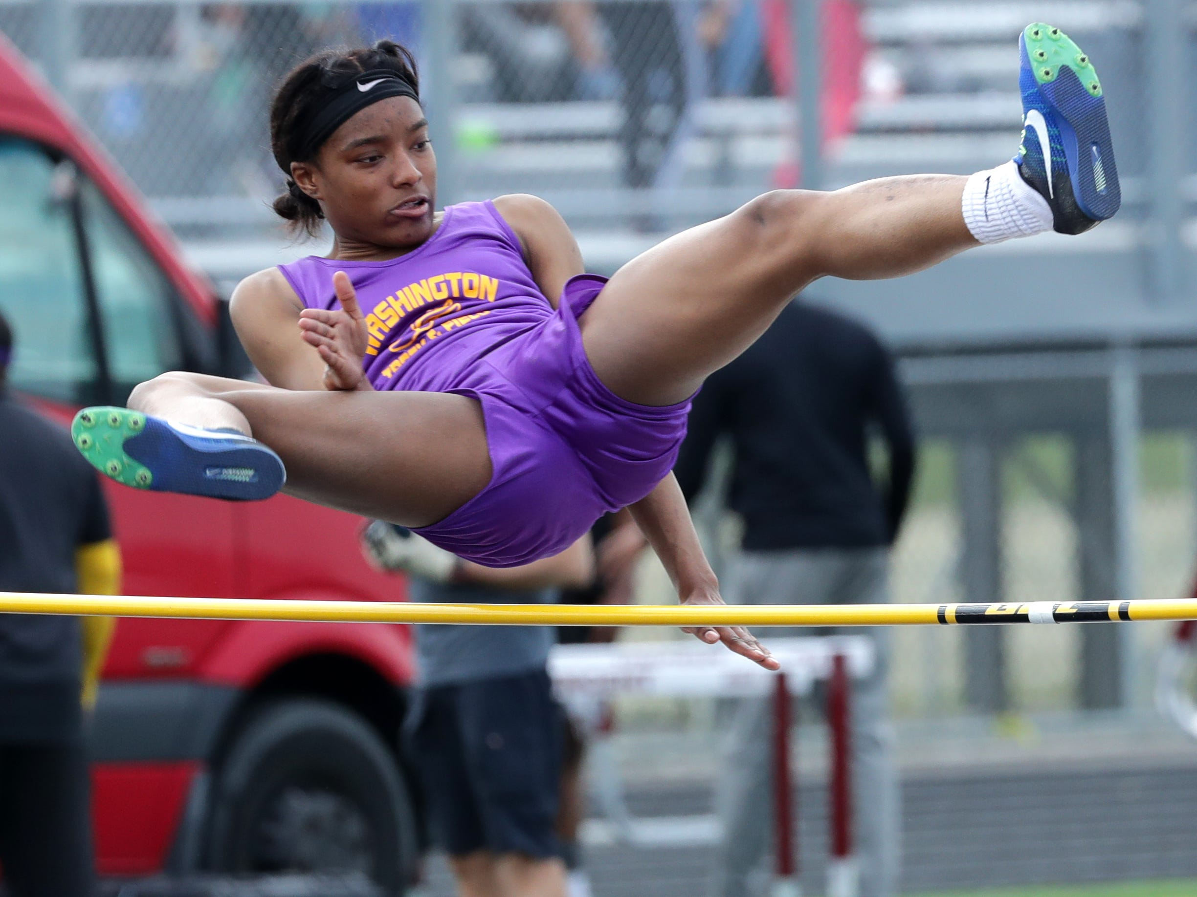 Milwaukee Washington's Destiny Mitchell competes in the high jump.